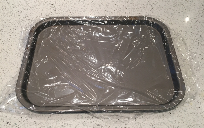 Baking sheet lined with cling film